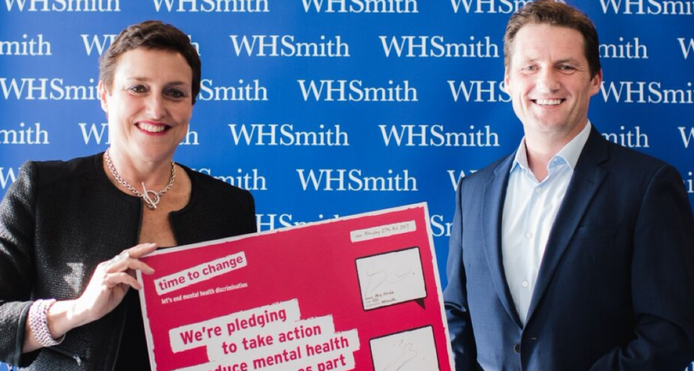 The Director of Time to Change and the Chief Executive of WHSmith with their signed Time To Change Employer Pledge card