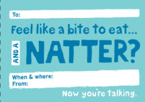 A postcard which reads: Feel like a bite to eat and a natter?