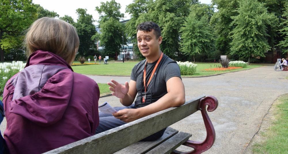 An outreach team member talks to a homeless person.
