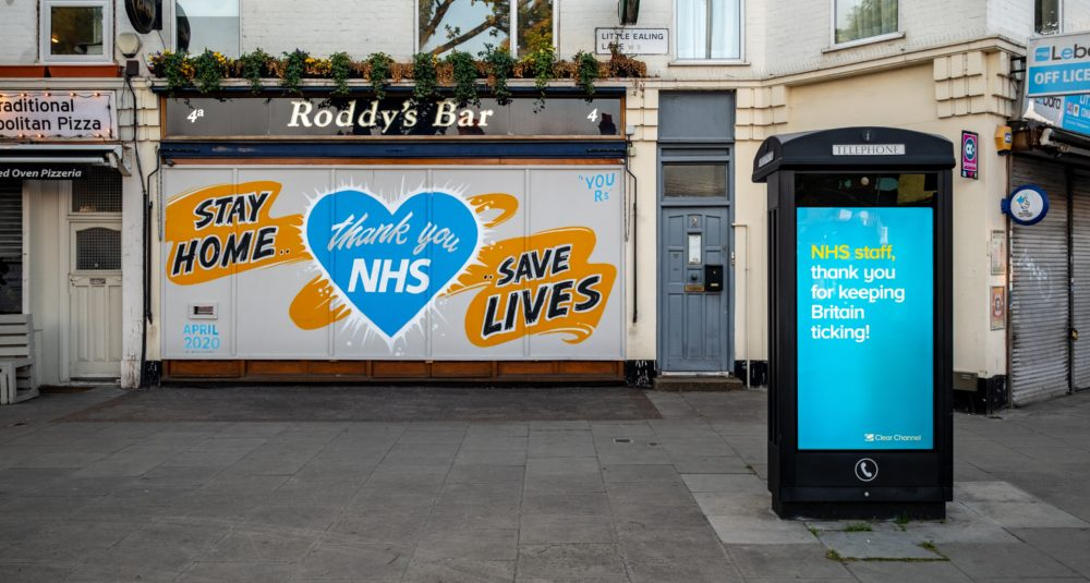 A bar's shutters display a thank you message to the NHS.
