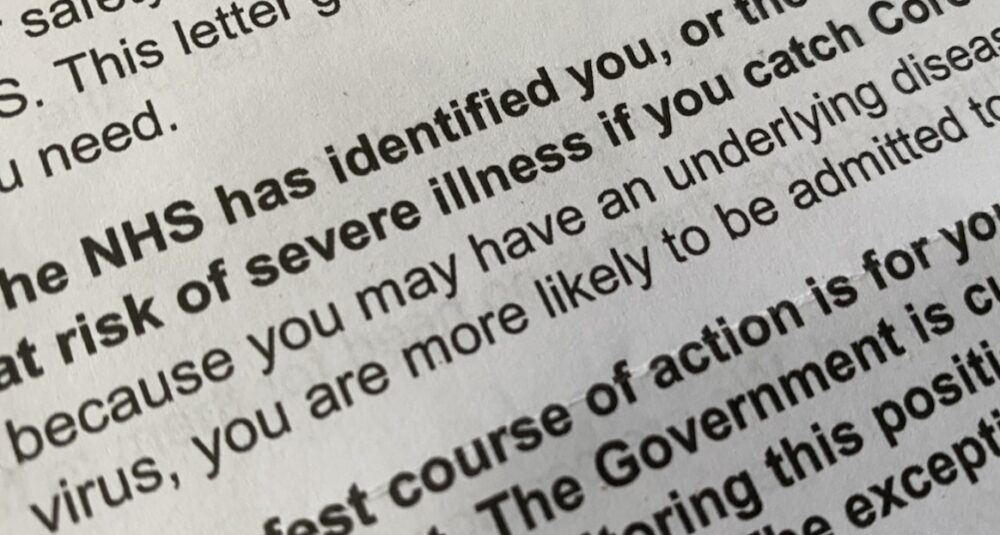 A letter from the NHS informing somebody that they are at risk of severe illness if they catch coronavirus